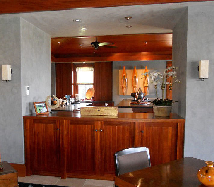 Warm wood tones harmonize with cool tones in the Venetian Plaster in this Luxury residence in Kukio on Hawaii's Big Island.