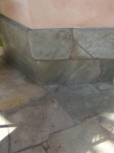 Thompson Art Studios replicates a lanai's stone surface with faux paint to mask the surrounding trim work.