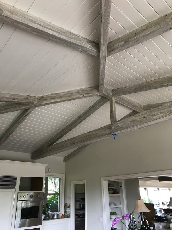 Thompson Art Studios specializes in fake wood grain like the silvery finish on these ceiling beams.